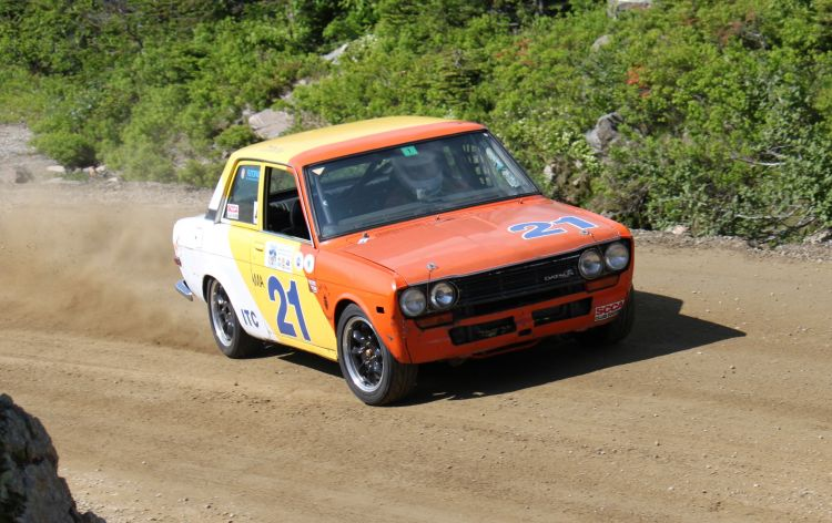 Dave Patten in his 1971 Datsun 510 under power at the Cragway hairpin on Saturday's practice run (6/28/14). Photo by Chris Barnes.